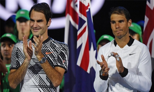 Nadal, Federer ease through