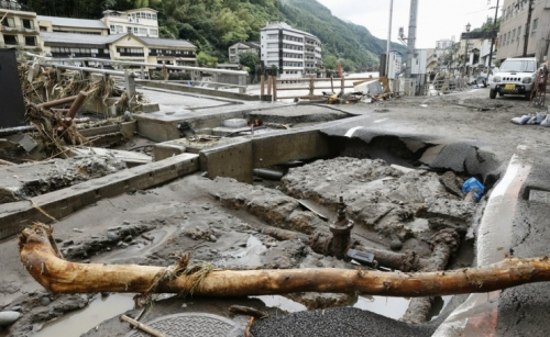 Japan battered by more heavy rain, floods, nearly 60 dead