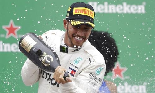Hamilton wins nail-biting Brazilian GP