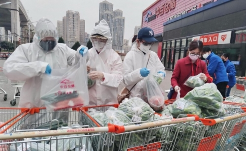 China reports 101 new cases as outbreak intensifies