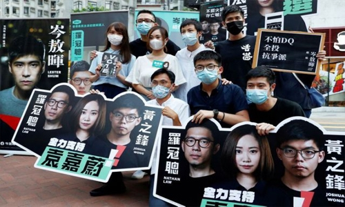 Hong Kong democracy activists arrested under security law as crackdown intensifies