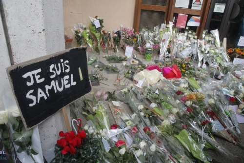 More police operations under way over killing of French teacher: minister