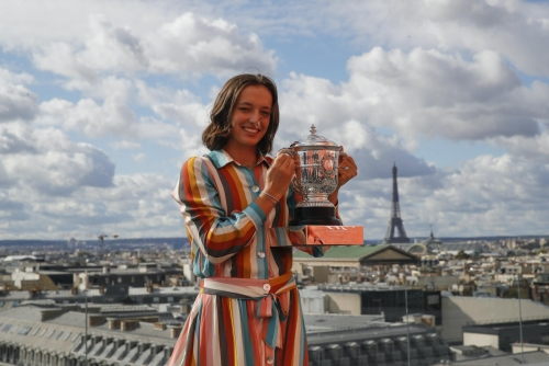 Swiatek writes history with French Open triumph