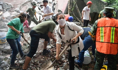 21 schoolchildren among nearly 250 dead in powerful Mexico quake