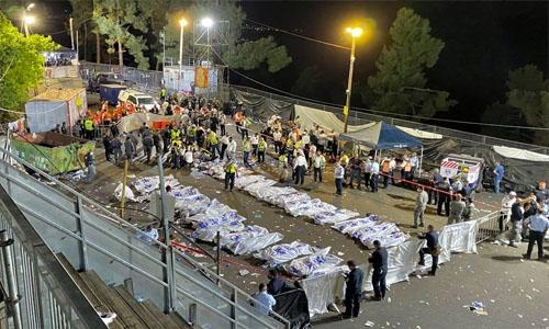 Medics work to identify the 45 killed in Israeli stampede