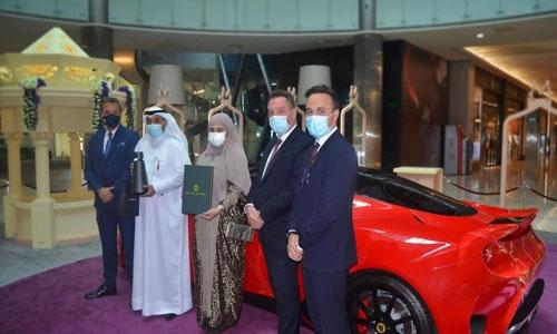 MODA Mall hands over keys to Lotus GT Evora Grand Prize winner