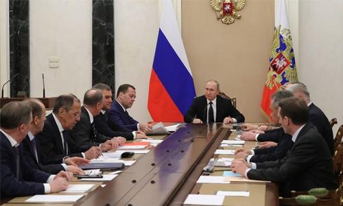 Russia says to retaliate  soon for UK's expulsion