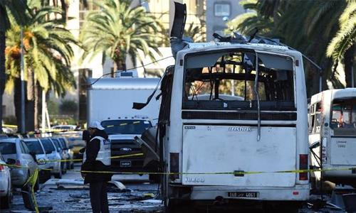 Tunisia names three suspects wanted over bus bombing