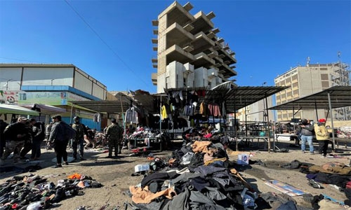 Islamic State group claims responsibility for deadly twin bombing in Baghdad; Bahrain condemns act