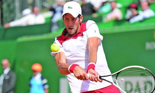 Djokovic thrashes Lajovic