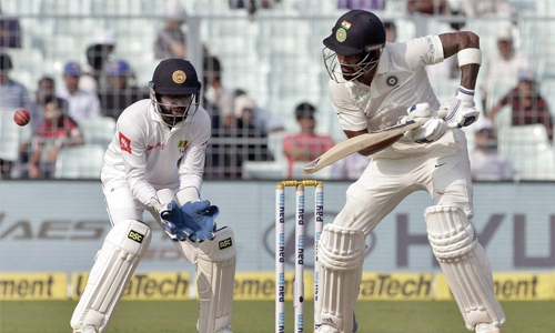 Rahul, Shikhar Dhawan carry India into lead
