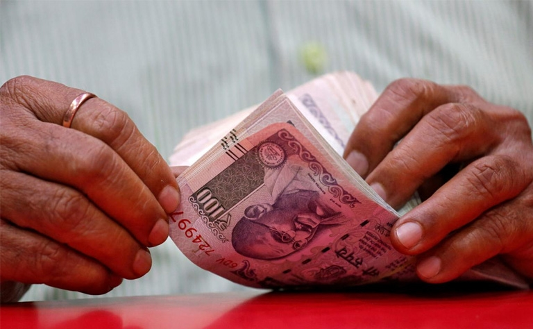 Indian Rupee pulls back from record low