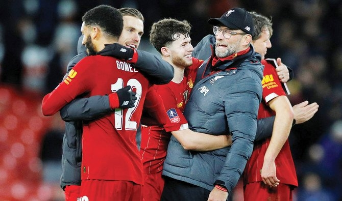 Liverpool march toward history as top-four race heats up