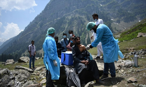 Indian medical workers scale mountains to bring vaccines to remote corners