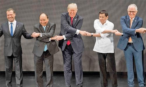 Handshake challenge: He grimaces, grins, grips