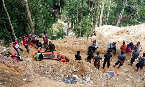 Six dead, dozens buried in Indonesia mine collapse