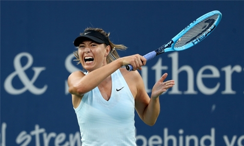 Sharapova win sets up Barty battle