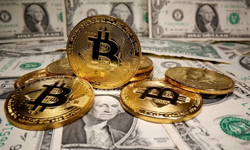 Dollar held down by doubts over US recovery; bitcoin retreats from record high