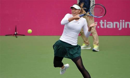 Sharapova battles  past Linette