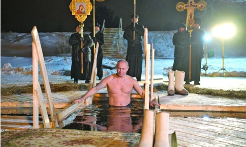 Putin takes subzero dip in icy lake to mark Orthodox Christian feast