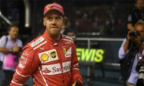 Stunning Vettel grabs pole