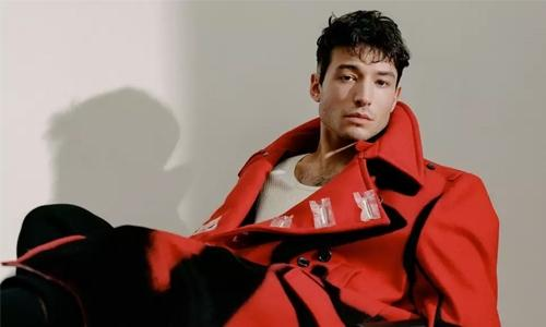 Ezra Miller pretends to be happy