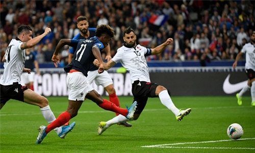 Coman brace helps France ease past Albania