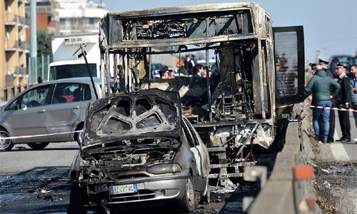 Italy driver hijacks, torches school bus
