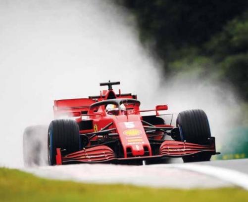 Vettel fastest in wet running