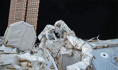 Astronauts take a spacewalk to lubricate robotic arm