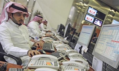 Saudi stocks hurt by telecom sector, Dubai flat