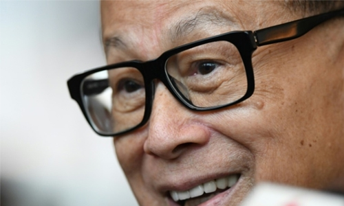 Hong Kong's wealthiest man donates $100m to local businesses